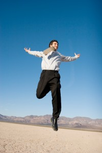 Happy salesperson jumping in the air