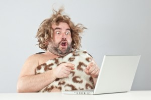 prehistoric man on laptop